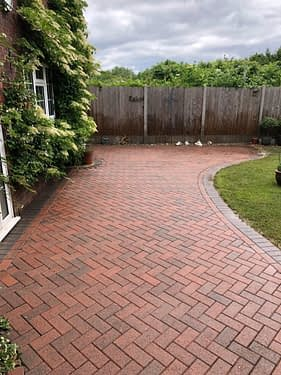 red block paving patio professionally cleaned and restored by Feel the pressure UK